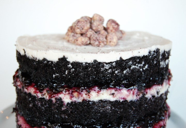 dark chocolate cake with blueberry preserves and liquid cheesecake